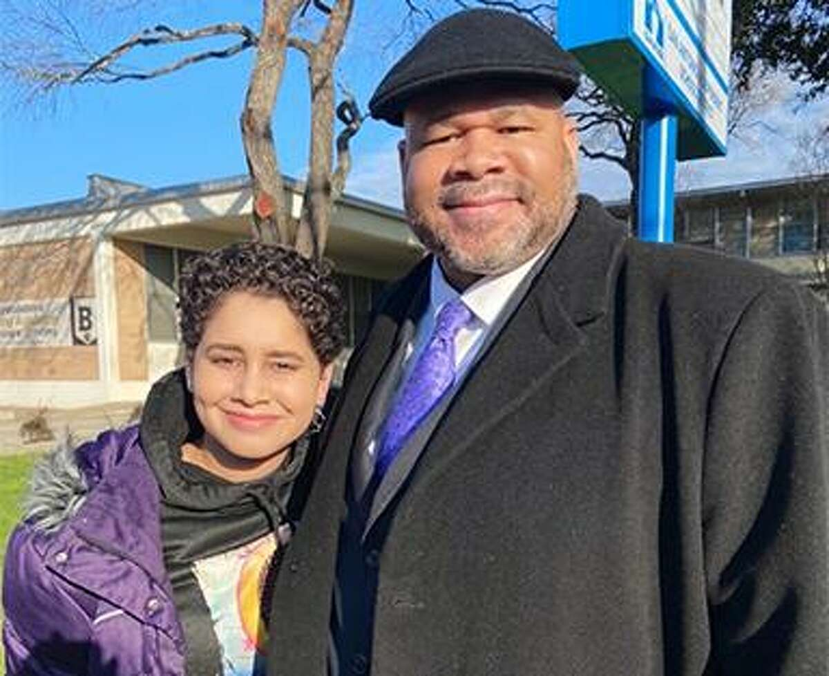 Carmen Grimes, 17, and her father, David Grimes, were among the more than 100,000 people who turned out for the 33rd Martin Luther King Jr. March on San Antonio's East Side. Grimes said it's a tradition that he walks in the march every year with at least one of this three daughters.