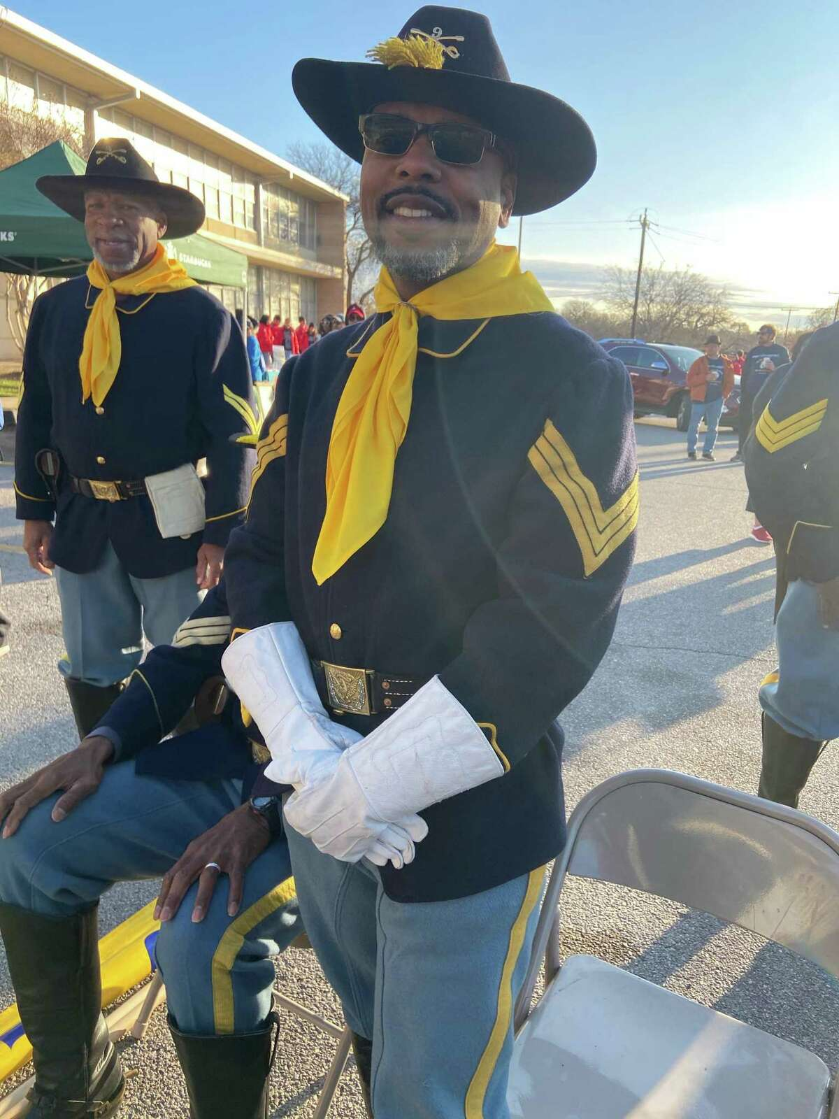Michael Young, 54, a Buffalo Soldier reenactor who was born in Memphis but lives in San Antonio now, talks with visitors before the start of the 33rd Martin Luther King Jr. March on Monday in front of MLK Jr. Academy on MLK Jr. Drive.