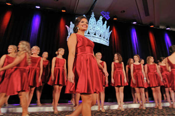 Miss Jersey County Fair Sara Lamer walks across the stage as contestants are introduced during the pageant.