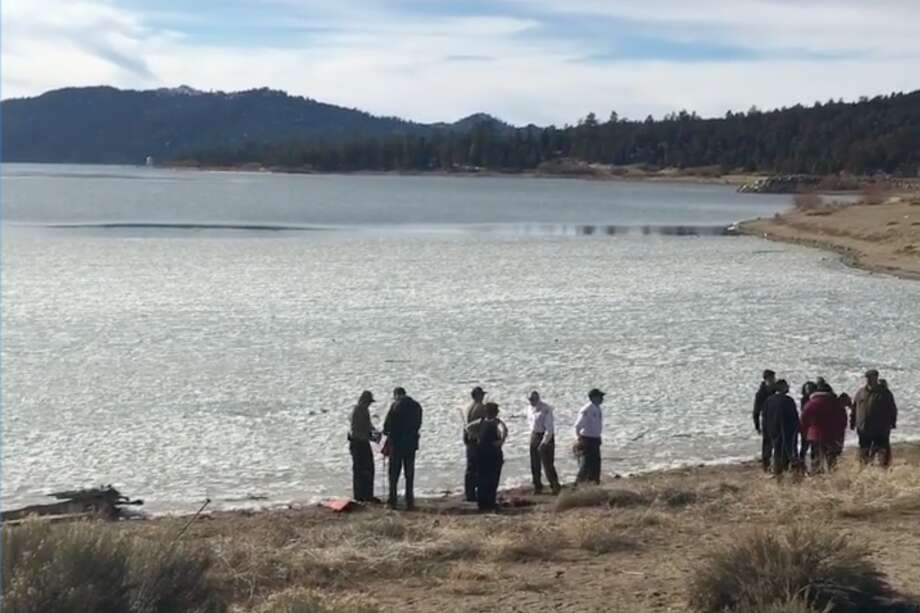 California family falls through ice into frozen lake