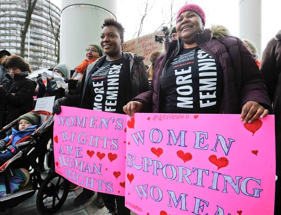 Marie Rocha left, and Nikki Hurse, both of Stamford, join with hundreds of participants who braved cold weather to attend the #PinkWave2020: Rally for Women's Rights in front of the Stamford Government Center Saturday. Photo: Matthew Brown / Hearst Connecticut Media / Stamford Advocate