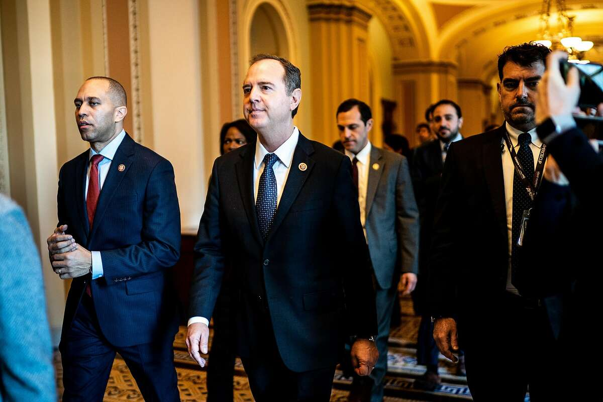 Reps. Hakeem Jeffries (D-N.Y.), left, and Adam Schiff (D-Calif.) walk with other House impeachment managers to do a walkthrough of the Senate floor and their office space on the Senate side of the Capitol they will use during the impeachment trial of President Donald Trump in Washington on Monday, Jan. 20, 2020. (Erin Schaff/The New York Times)