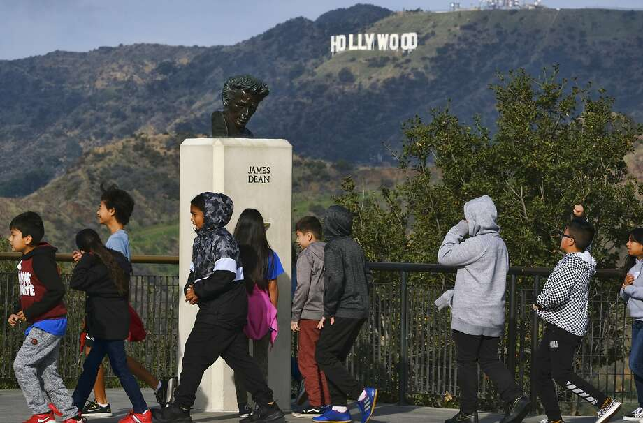 Students walk past a bust of actor James Dean during a field trip to Griffith Observatory in Los Angeles. Photo: Richard Vogel / Associated Press
