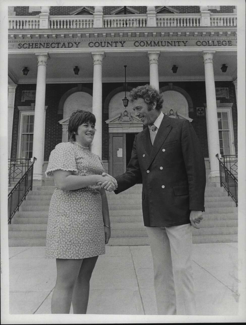Molly Ergmann is greeted by Francis A. Mullin, director of admissions, at Schenectady County Community College in 1972.
