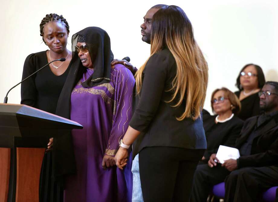 Omo Mohammed (second from left), mother of slain teen Mubarak Soulemane, speaks during The Greater New Haven Clergy Association's Celebrating the Life & Legacy of Martin Luther King, Jr., at First Calvary Baptist Church in New Haven on January 20, 2020. From left are Mubarak's cousin, Rakiya Adams, of Mt. Vernon, New York, his mother, uncle, Tahir Hohammad, of New York City and cousin, Laura Kuta, of Norwalk. Photo: Arnold Gold / Hearst Connecticut Media / New Haven Register
