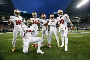 Dante Pettis, Deebo Samuel, Kendrick Bourne, Emmanuel Sanders, Richie James Jr., and Jimmy Garoppolo of the San Francisco 49ers pose for a photo on the field prior to game against the Seattle Seahawks at CenturyLink Field on December 29, 2019 in Seattle, Washington. The 49ers defeated the Seahawks 26-21.