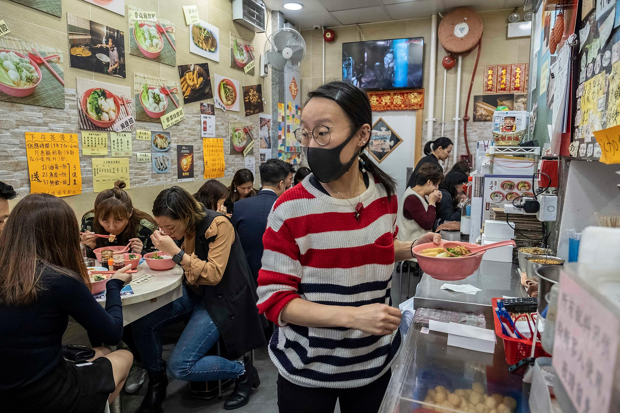 Yellow or blue? In Hong Kong, businesses choose political sides