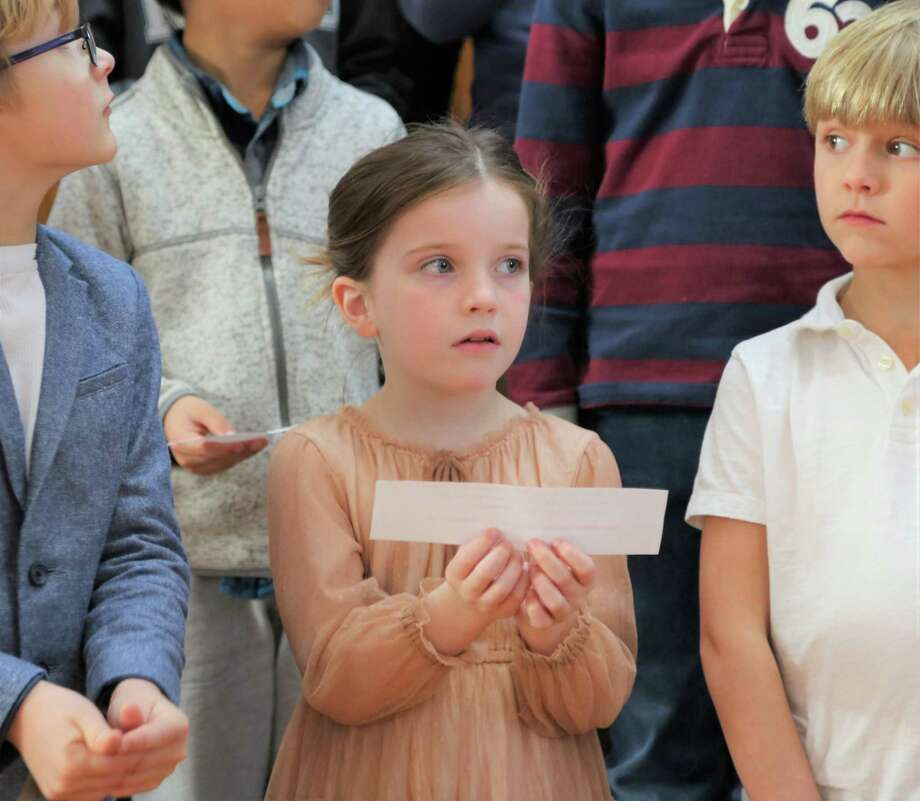 "Grace Overman of Darien recited a portion of the Rev. Dr. Martin Luther King Jr.'s ""I have a Dream"" speech at the Lower School assembly at New Canaan Country School honoring the civil rights leader last week. Photo: New Canaan Country School / Contributed Photo / New Canaan Advertiser Contributed"