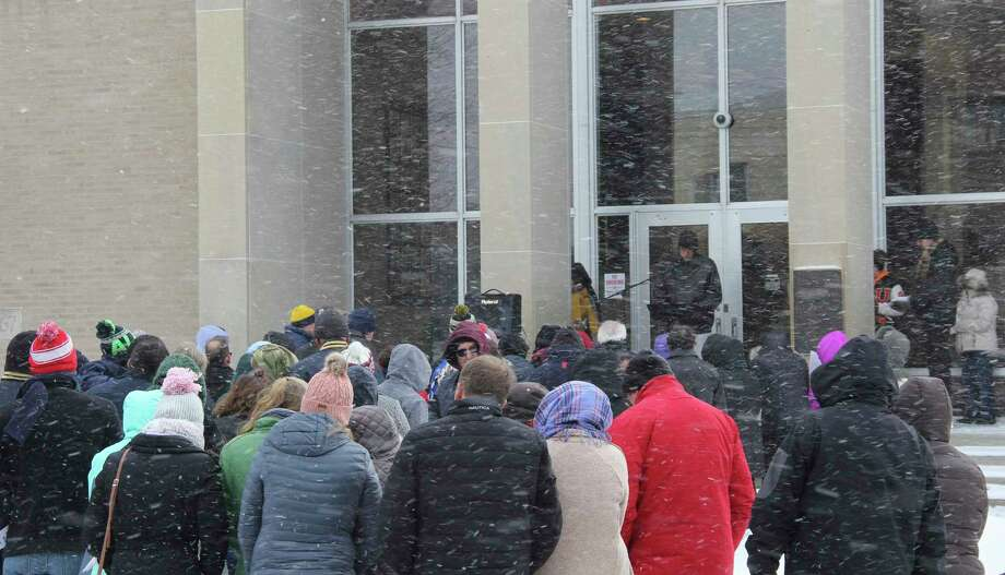 Members of Huron County Right to Life braved the winter cold for their annual memorial service in front of the Huron County Courthouse on Sunday. The service included a speech from Joel Leipprandt from Ubly High School, pictured above. (Robert Creenan/Huron Daily Tribune)