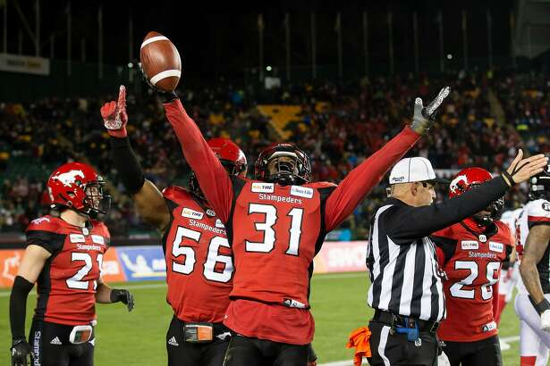 EDMONTON, AB - NOVEMBER 25: Tre Roberson #31 of the Calgary Stampeders celebrates an interception against the Ottawa Redblacks during the second half of the Grey Cup at Commonwealth Stadium on November 25, 2018 in Edmonton, Alberta, Canada. (Photo by Codie McLachlan/Getty Images)