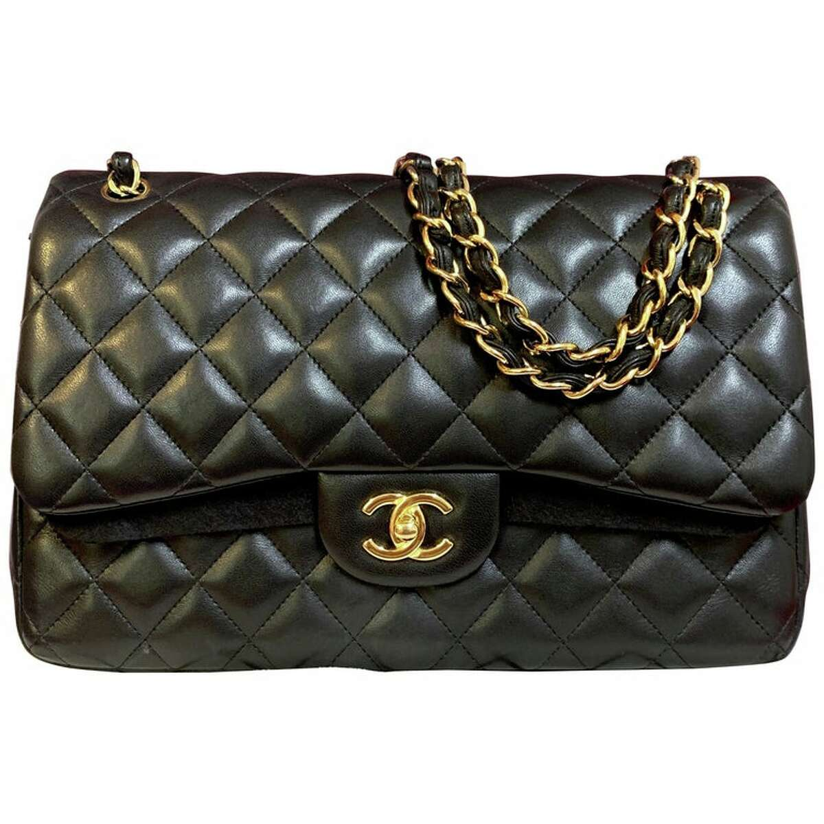 Chanel's iconic black quilted-leather flap bag
