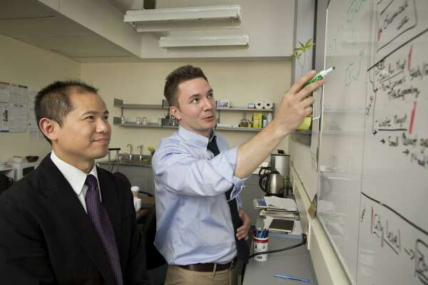 P2 Science co-founder and Chief Science Officer Patrick Foley, right, with Yonghua Yang, research chemist.