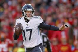 Tennessee Titans' Ryan Tannehill scrambles during the first half of the NFL AFC Championship football game against the Kansas City Chiefs Sunday, Jan. 19, 2020, in Kansas City, MO. (AP Photo/Jeff Roberson)