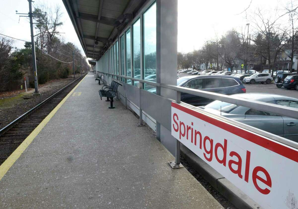 Cars are parked in the lot of the Springdale train station in the Springsdale section of Stamford, Conn. Monday, Jan. 6, 2020. Thanks to a $2 million state grant, the Spingdale station will undergo transformations to make it more accessible, including new parking lots, better lighting, redesigned sidewalks and intersections with high-visibility crosswalks, and an improved pick-up and drop-off area.