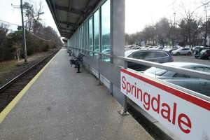 Cars are parked in the lot of the Springdale train station in the Springsdale section of Stamford on Jan. 6. Statistics released by the railroad on Monday show cancellations were down 55 percent and there were 41 percent fewer trains delayed more than 15 minutes
