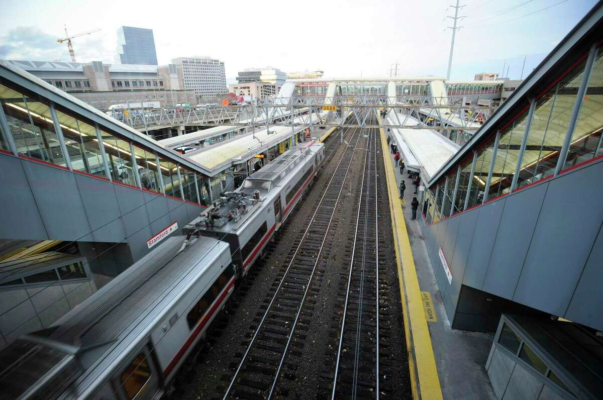 Metro-North commuter trains arrive and depart from the Stamford train station.