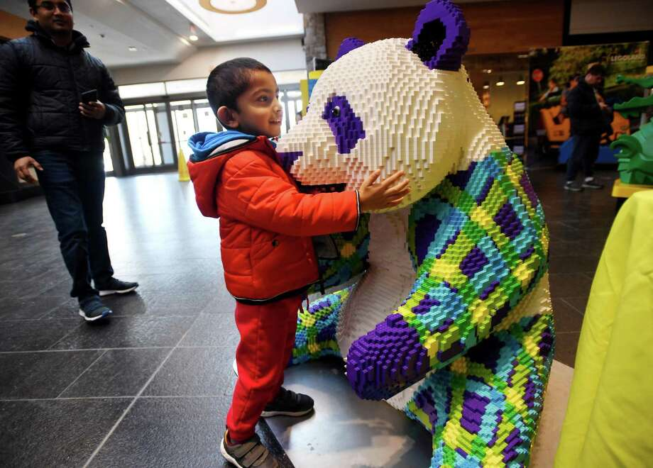 Ayansh Tiwari, 3, of Shelton, has a hug for a giant LEGO panda during LEGOLAND New York's visit to the Westfield Trumbull Mall in Trumbull, Conn. on Sunday January 19, 2020. LEGOLAND New York, the largest LEGOLAND theme park yet, is scheduled to open in Goshen, NY on July 4. The exhibit continues at the mall on Monday from 10 a.m.- 9 p.m. Photo: Brian A. Pounds / Hearst Connecticut Media / Connecticut Post
