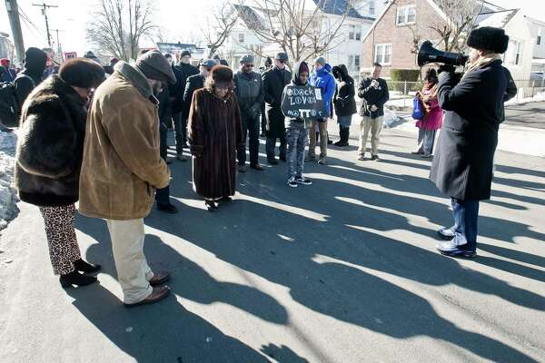 Reverend Johnny Bush, of Greater Faith Tabernacle Baptist Church, leads with a prayer before the annual MLK Day March, beginning at the Bethel AME Church in Stamford. Monday, Jan. 20, 2020