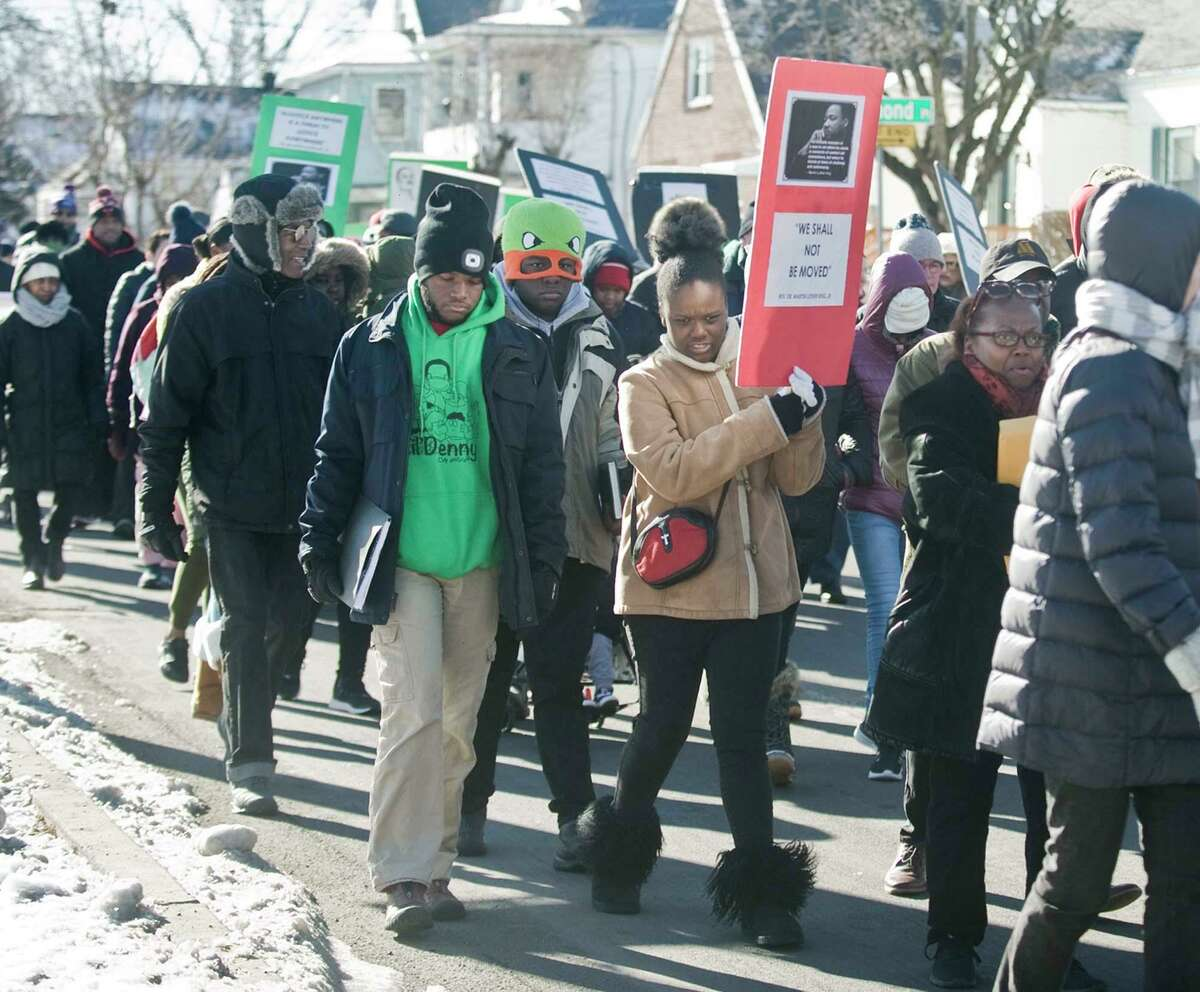 Walkers in the annual MLK Day March, beginning at the Bethel AME Church, head along Fairfield Avenue in Stamford on Monday.