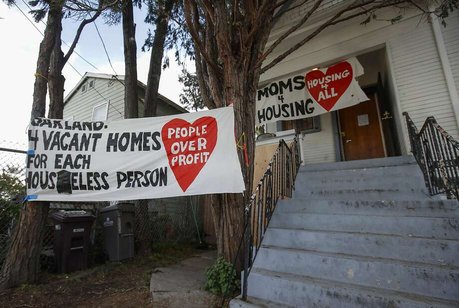 FILE - In this Jan. 14, 2020 file photo, signs are posted outside of a house was occupied by the group Moms 4 Housing in Oakland, Calif. The homeless mothers who were evicted last week from an Oakland house where they were squatting plan to buy the property after speculators, in a change of heart, agreed to sell it to a city nonprofit, it was announced Monday, Jan. 20, 2020. Photo: Jeff Chiu, Associated Press