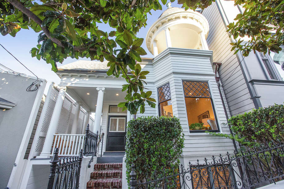 A classic Queen Anne in San Francisco's Eureka Valley at 251-253 Collingwood blends old-world details with modern conveniences. Photo: Open Homes Photography