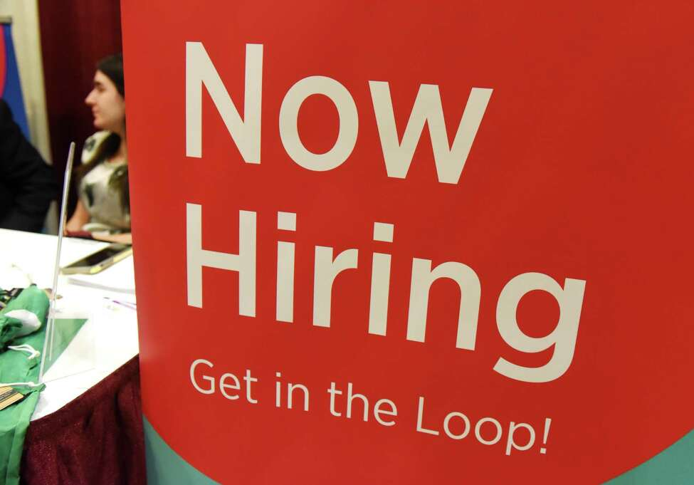 A hiring sign is displayed at the Tomra North America booth during the Times Union Job Fair on Monday, Jan. 20, 2020, at the Albany Marriott Hotel in Colonie, N.Y. (Will Waldron/Times Union)
