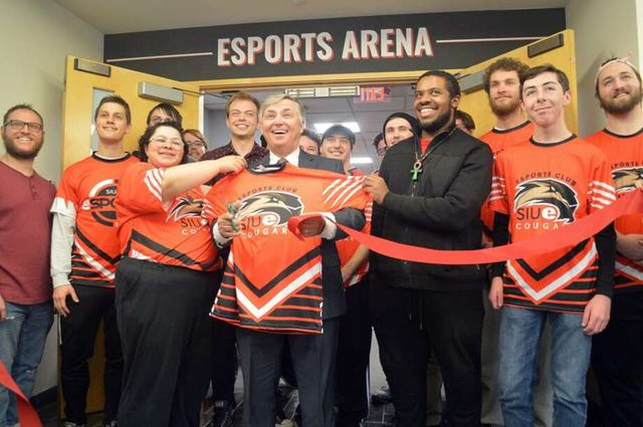 SIUE chancellor Randy Pembrook, center, takes part in the ribbon-cutting ceremony for the new SIUE Esports Arena at Bluff Hall.