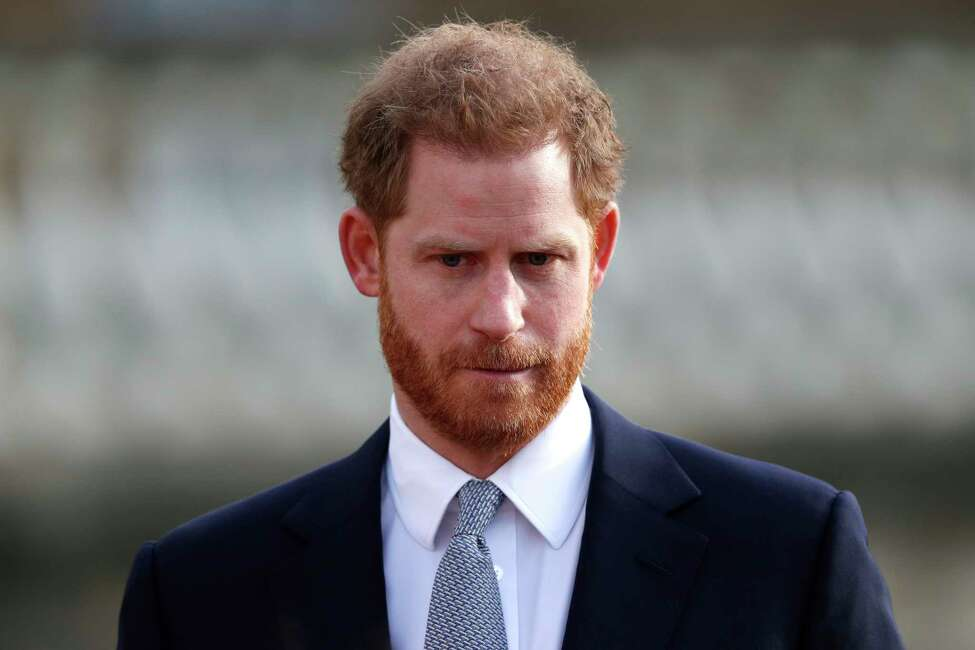 (FILES) In this file photo taken on January 16, 2020, Britain's Prince Harry, Duke of Sussex watches children play rugby league prior to the draw for the Rugby League World Cup 2021 at Buckingham Palace in London. - Britain's Prince Harry expressed