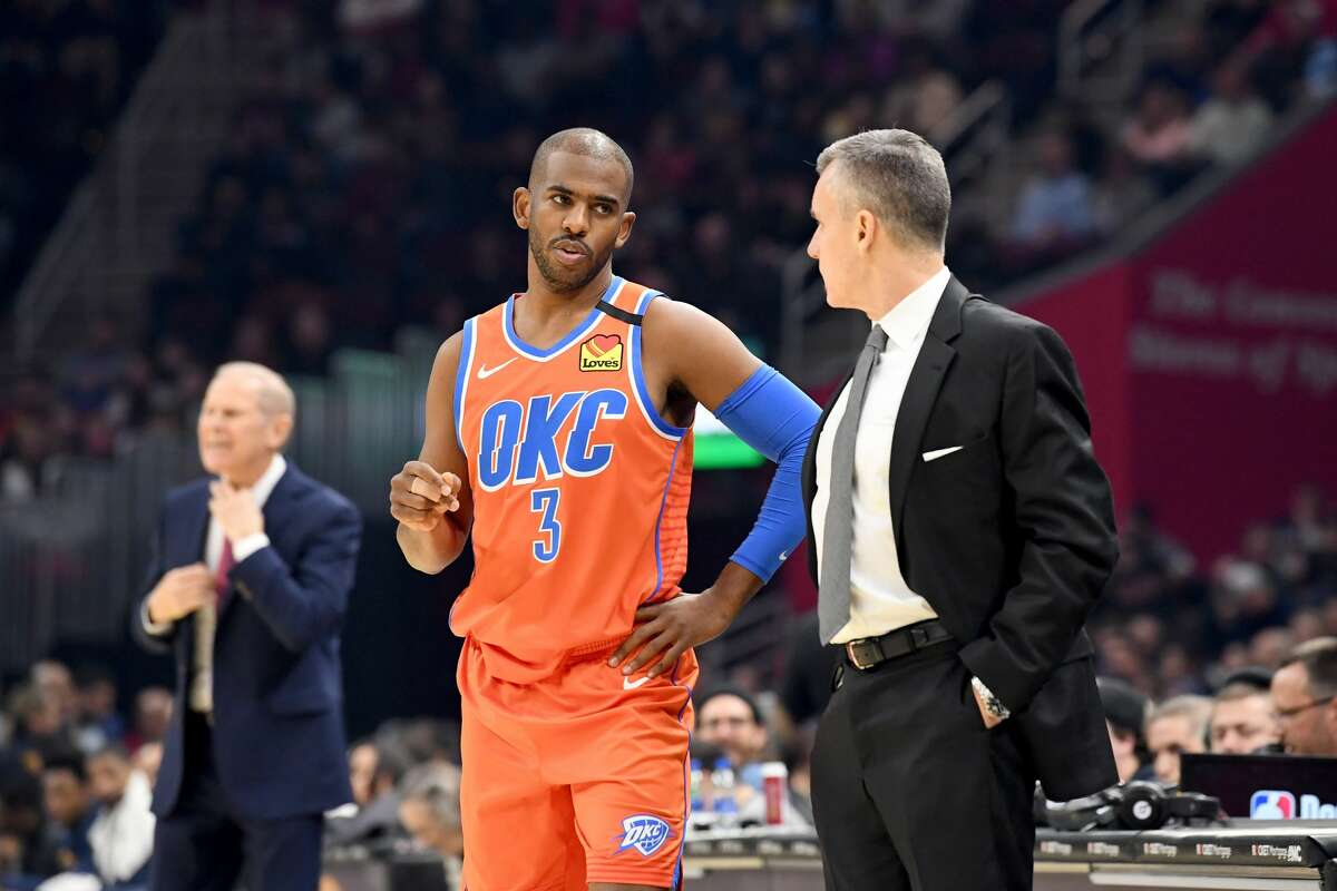 CLEVELAND, OHIO - JANUARY 04: Chris Paul #3 talks with head coach Billy Donovan of the Oklahoma City Thunder during the first half against the Cleveland Cavaliers at Rocket Mortgage Fieldhouse on January 04, 2020 in Cleveland, Ohio. NOTE TO USER: User expressly acknowledges and agrees that, by downloading and/or using this photograph, user is consenting to the terms and conditions of the Getty Images License Agreement. (Photo by Jason Miller/Getty Images)