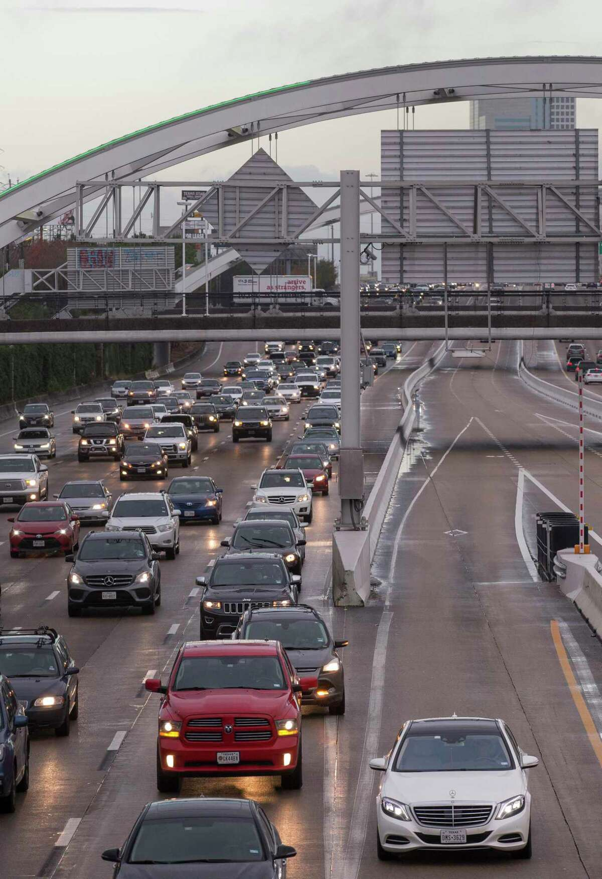 Motorists use the HOT lane of Interstate 69 northbound on the morning of Dec. 13, 2018 toward downtown Houston.