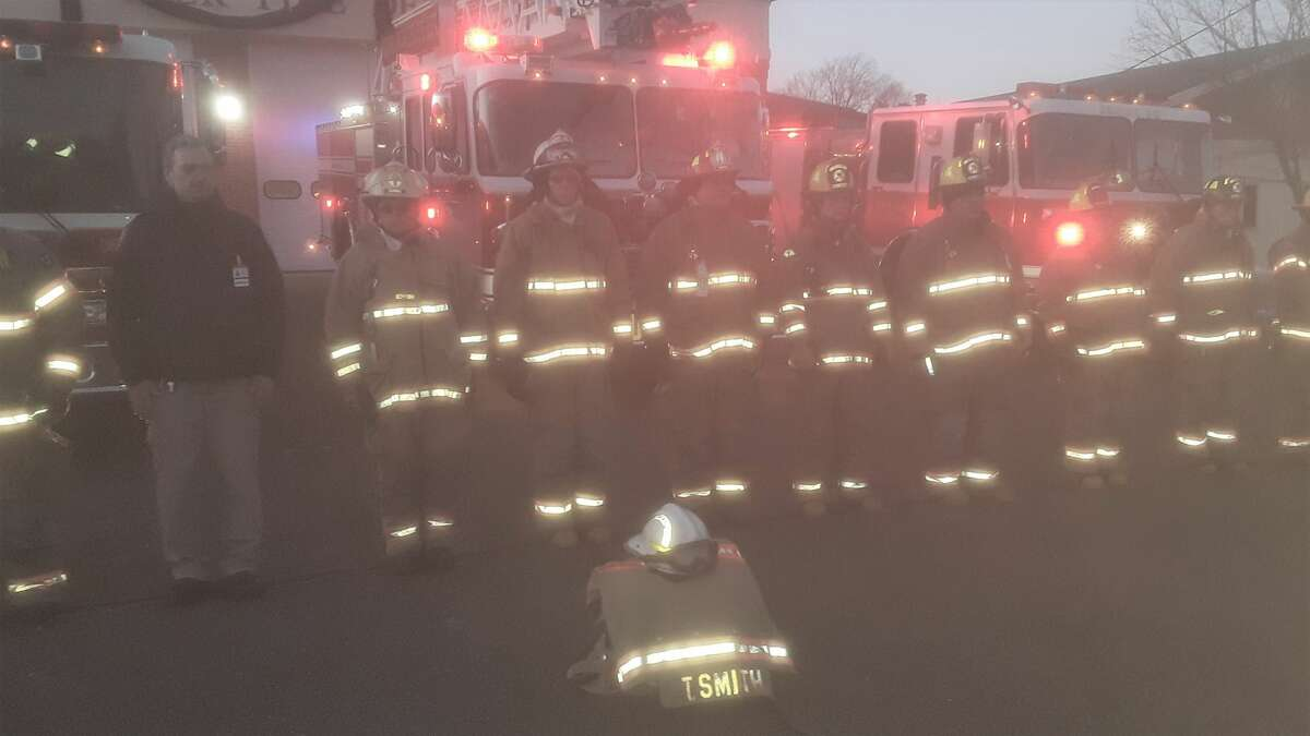 The body of Fire Marshal Tim Smith was escorted past the town's main firehouse Monday to Cody-White Funeral Home by state and orange police. Fire Chief Vaughn Dumas and Deputy Fire Marshal James Vincent rode in the procession as firefighters, the auxiliary, First Selectman Jim Zeoli saluted their friend and colleague. The uniform in front on the ground belonged to Smith.