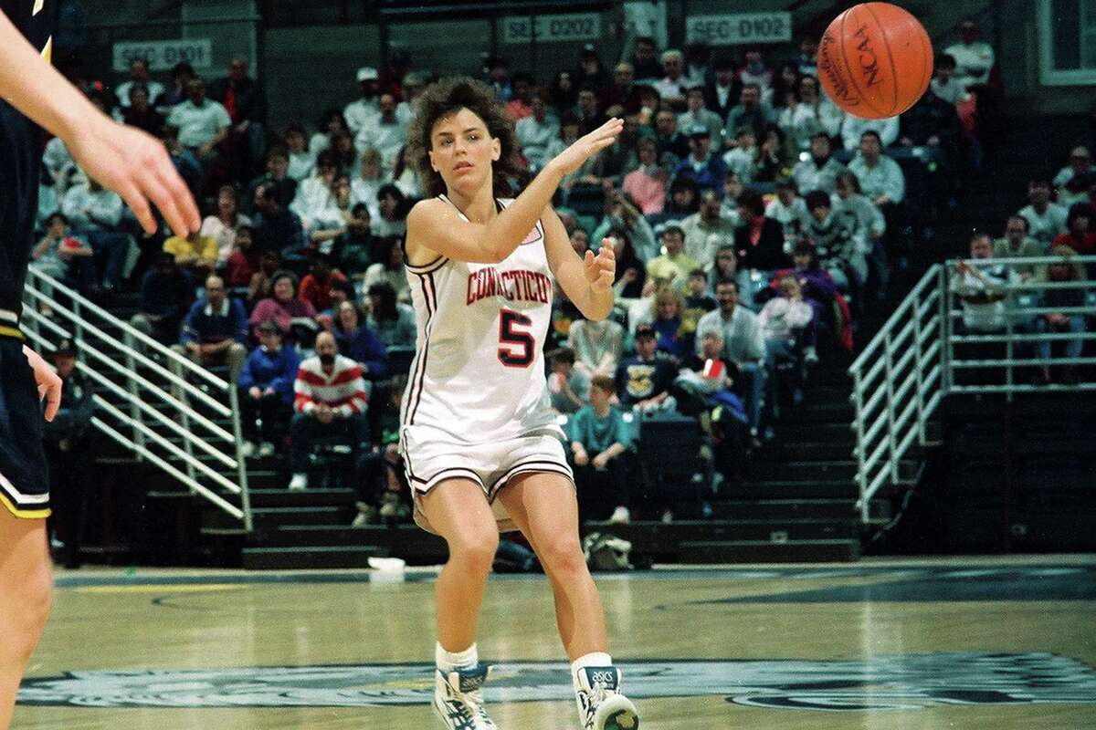 American basketball player Debbie Baer of the University of Connecticut passes the ball during a game againts the University of Iowa, in Gampel Pavilion, Storrs, CT, 1991. (Photo by Bob Stowell/Getty Images)