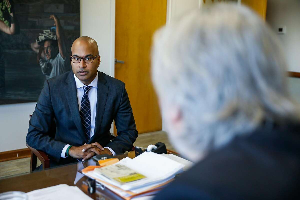 Newly appointed Public Defender Mano Raju (left) listens during a meeting with Chief Attorney Matt Gonzalez (right) and Chris Gauger (not pictured) at the Public Defender's offices in San Francisco, California, on Thursday, March 14, 2019.