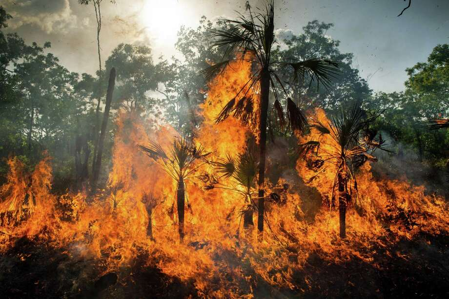 A fire rages in Australia. Blaming others for wildfires doesn't help address the conditions that led to them. Neither does inaction on climate change. Photo: MATTHEW ABBOTT /NYT / NYTNS