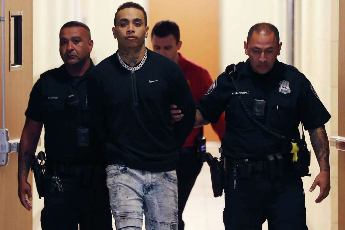 Kiernan Christopher Williams is led out of San Antonio Public Safety Headquarters after his arrest on capital murder charges, Monday, Jan. 20, 2020. Williams in charged in the death of Robert Martinez, 20, and Alejandro Robles, 25, at the Ventura San Antonio club on the Riverwalk Sunday night. According to police he opened fire inside the bar killing the two and injuring five others.