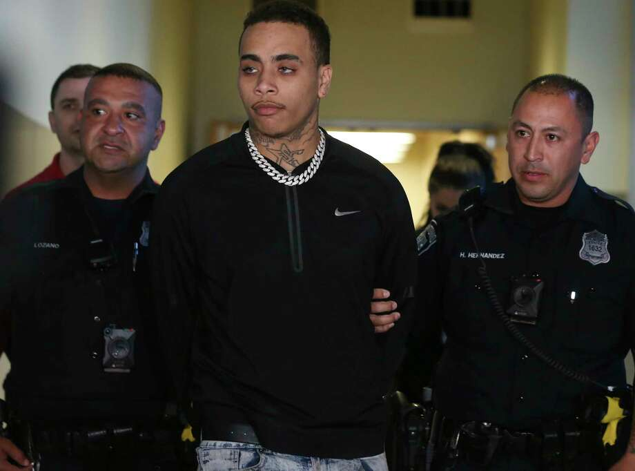 Kiernan Christopher Williams is led out of San Antonio Public Safety Headquarters after his arrest on capital murder charges, Monday, Jan. 20, 2020. Williams in charged in the death of Robert Martinez, 20, and Alejandro Robles, 25, at the Ventura San Antonio club on the Riverwalk Sunday night. According to police he opened fire inside the bar killing the two and injuring five others. Photo: Jerry Lara, Staff Photographer / **MANDATORY CREDIT FOR PHOTOG AND SAN ANTONIO EXPRESS-NEWS/NO SALES/MAGS OUT/TV   © 2019 San Antonio Express-News