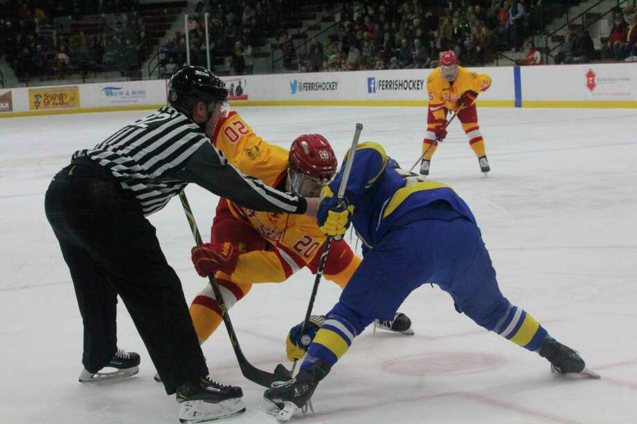 Ferris' Liam MacDougall (20) gets ready to take the faceoff against Alaska on Saturday. (Pioneer photo/John Raffel)