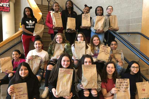 """The Shelton Intermediate School Team Corp put together """"grab-and-go"""" bags for those staying at Spooner House. The bags were decorated with inspirational quotes from Dr. Martin Luther King, Jr., as well as their own words to spread the message of kindness."""
