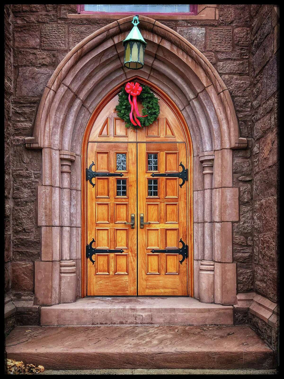 Retired Middletown police chief and photographer Lynn Baldoni began a project a month ago to take pictures of doors of buildings and homes throughout the city. Shown here is St. Johns Church on St. Johns Square.