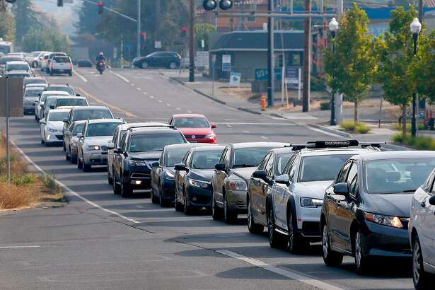 Traffic jams Dry Creek Road in Healdsburg, Calif., after authorities ordered the evacuation of the city on Saturday, Oct. 26, 2019, ahead of strong winds that could fan the Kincade fire.
