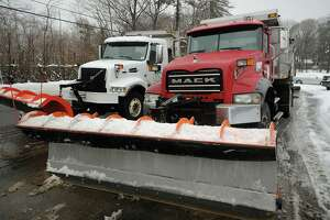 A 2014 file photo showing a pair of plow trucks loaded with salt at Stratford's Department of Public Works.