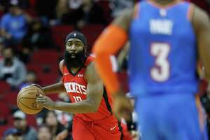 Houston Rockets guard James Harden (13) gets a rebound during the first half of an MBA basketball game at Toyota Center, in Houston, Monday, Jan. 20, 2020.