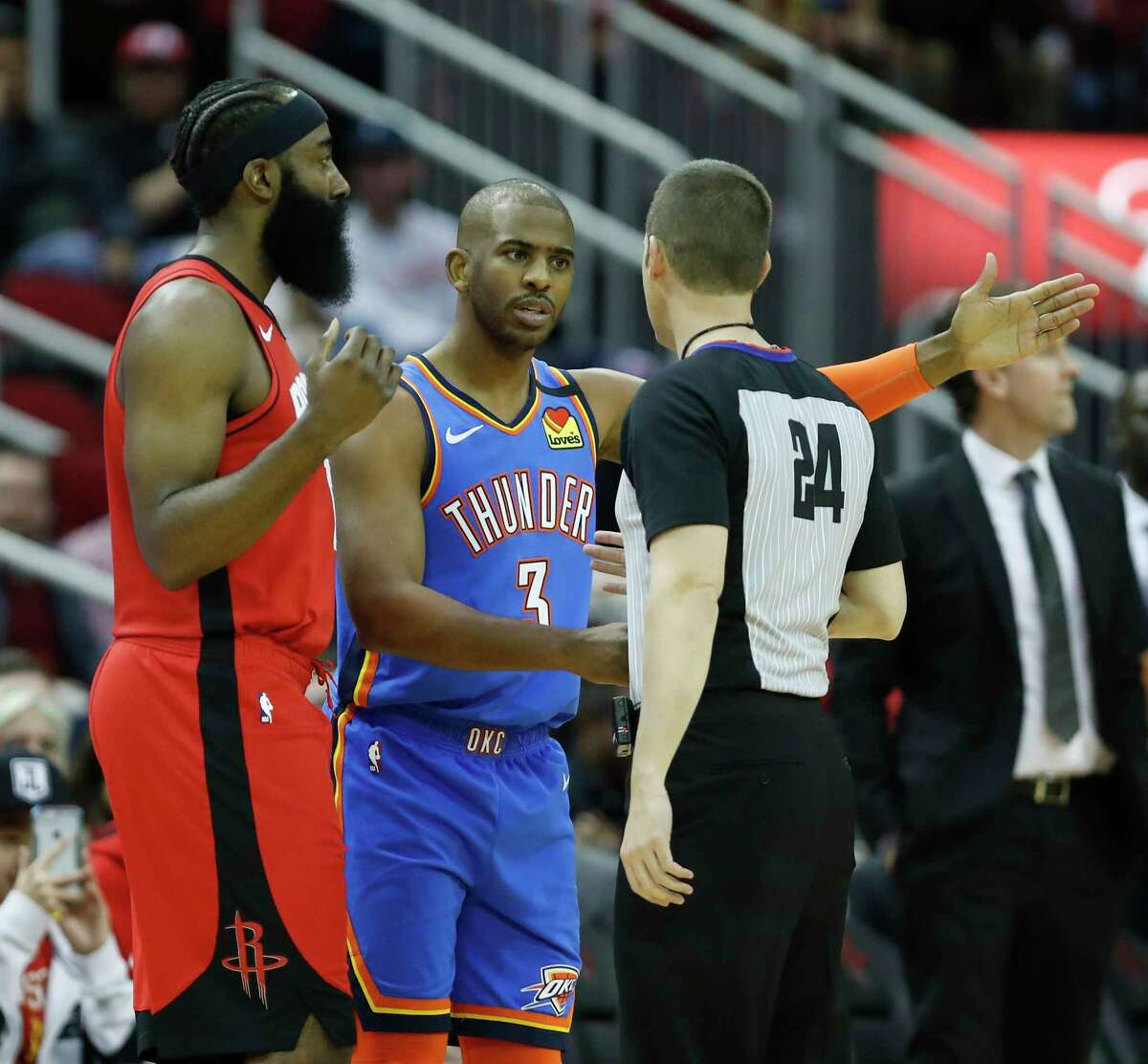 Oklahoma City Thunder guard Chris Paul (3) and Houston Rockets guard James Harden (13) argue with referee Kevin Scott (24) during the first half of an MBA basketball game at Toyota Center, in Houston, Monday, Jan. 20, 2020.