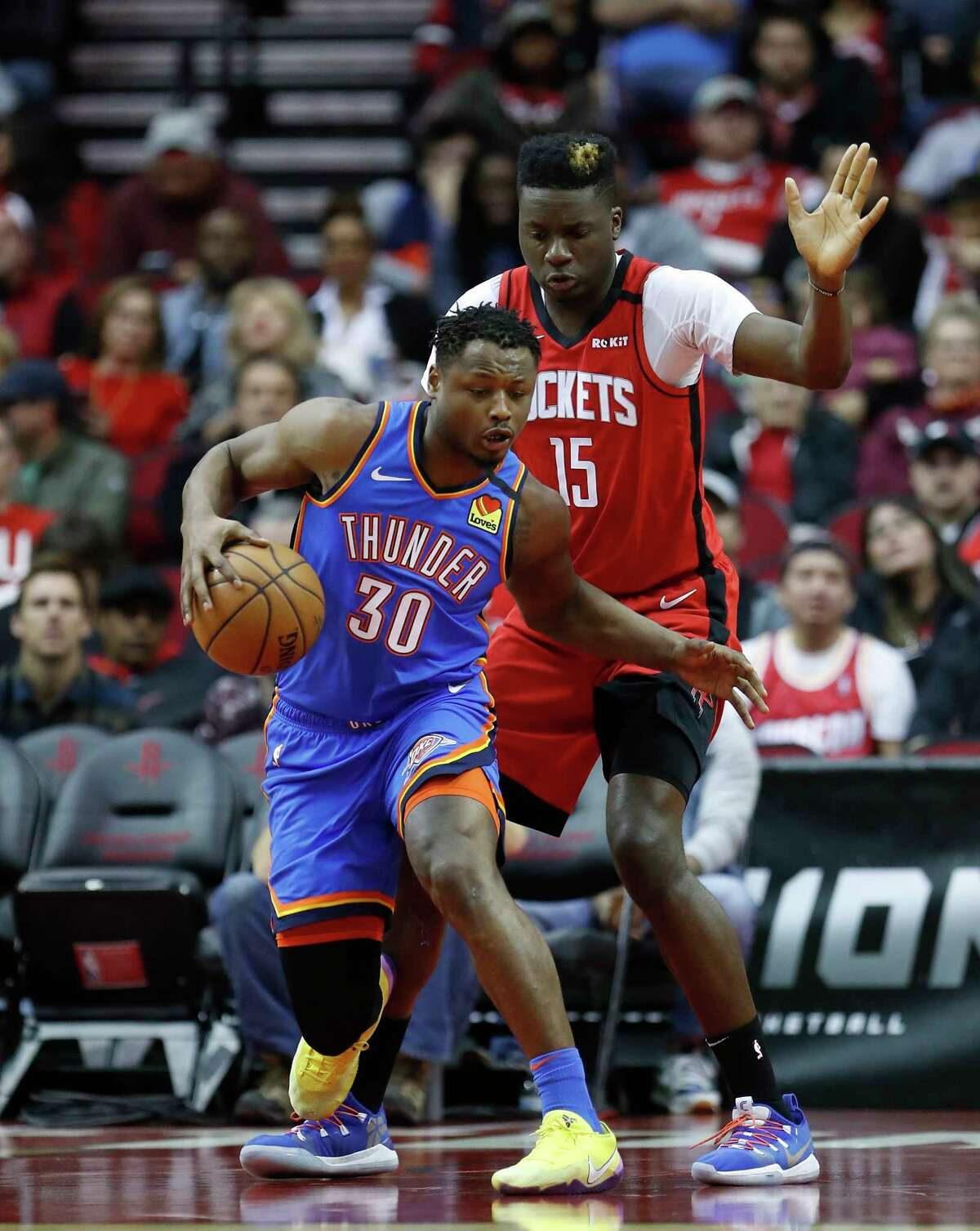 Houston Rockets center Clint Capela (15) tries to defend the goal against Oklahoma City Thunder guard Deonte Burton (30) during the first half of an MBA basketball game at Toyota Center, in Houston, Monday, Jan. 20, 2020.