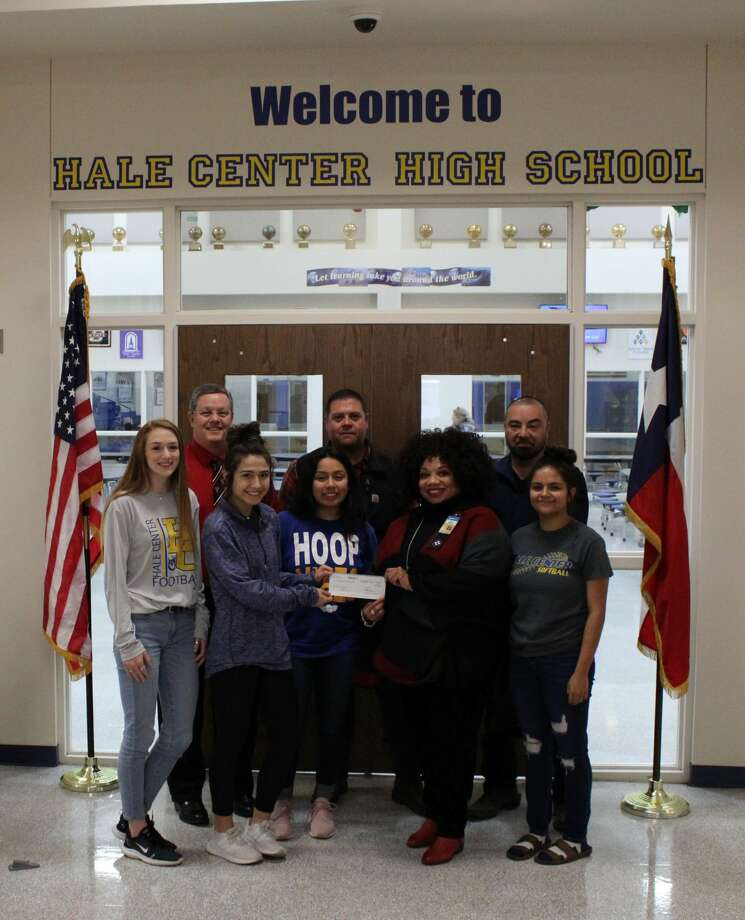 Members of the Walmart Transportation team in Plainview present a $2,000 donation to Hale Center ISD on Jan. 15. The funds were collected through the company's Miles For Education fundraiser. Pictured: (front row) Katy Huffhines, Avery Aleman, Vanessa Calderon, general transportation manager Tonya Morris, and Jessica Rodriguez; (back row) Hale Center High School principal Carlon Branson, Walmart shop operations manager Matthew Lopez, safety operations manager Troy Valdivia Photo: Courtesy Photo/Walmart Transportation Plainview