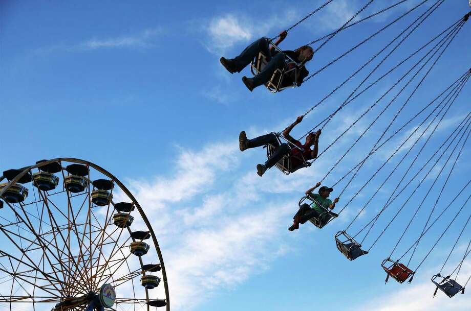 The carnival has been moved to a larger area in Parking Lot No. 4. The new location has room for a dozen more rides than last year, for a total of 60. Photo: Kin Man Hui /Staff File Photo / ©2019 San Antonio Express-News