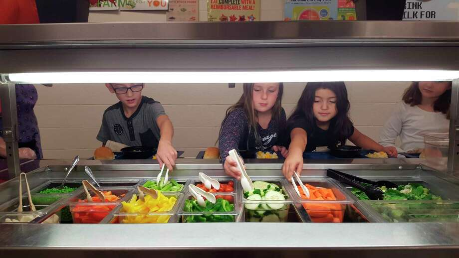 One of the many popular stops for students in the lunch program at Onekama Consolidated Schools is the salad bar. Food service director Tim Klenow said they will continue to provide a full salad bar at the school even if the new lunch program guidelines are put in place. (Courtesy photo)
