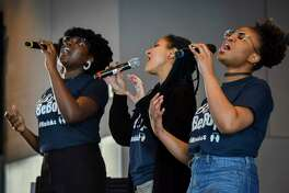 Howard University music students Ekep Nkwelle, left, Indigo Una and Halo Wheeler - a.k.a. Soul Sistas - entertain visitors at the National Museum of African American History and Culture.