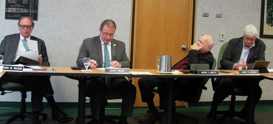 West Shore Community College president Scott Ward (second from left) explains to the WSCC Board of Trustees about the decision to recommend The Christman Company of Grand Rapids as the project manager for the Downtown Manistee Education Center. (Ken Grabowski/News Advocate)