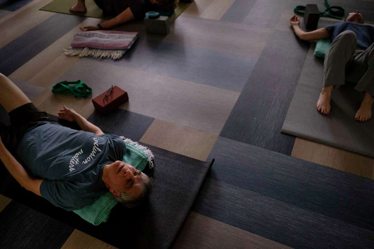 Alonzo Jusso lays back during a yoga class at the San Antonio Oasis on Jan. 15, 2020. The mission of Oasis is to provide healthy aging through active lifestyles, lifelong learning and volunteering.